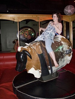 URBAN COWGIRL: The mechanical bull in Daisy Dukes - ANGUS LAMOND