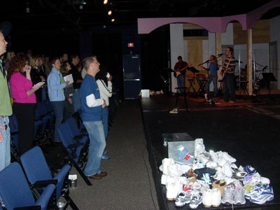 Watershed congregation listens to an alt-rock church band at Actor's Theatre. - ANGUS LAMOND