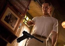 MURRAY CLOSE / FOX - WEAPON X: Eric Lehnsherr (Michael Fassbinder) arms himself in X-Men: First Class.