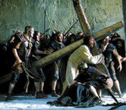 WEIGHT ON HIS SHOULDERS Jesus (Jim Caviezel) - carries the symbol of His own demise in The - Passion of the Christ