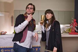 MELISSA MOSELEY / WARNER BROS. - WHEN HARRY MET CARREY: With Allison (Zooey Deschanel) at his side, Carl (Jim Carrey) attends a Harry Potter-themed party in Yes Man.