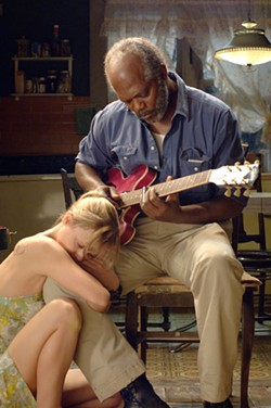 BRUCE TALAMON / PARAMOUNT CLASSICS - WHILE MY GUITAR GENTLY WEEPS Rae (Christina Ricci) and Lazarus (Samuel L. Jackson) form an unusual bond in Black Snake Moan