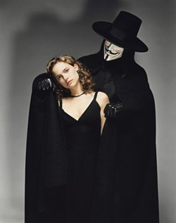 CLAUDIO CARPI / WARNER BROS. - WHO WAS THAT MASKED MAN? Evey (Natalie Portman) learns that the true identity of V (Hugo Weaving) is shrouded in mystery in V For Vendetta.