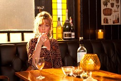 SONY PICTURES CLASSICS - WINE AND WHINE: Mary (Lesley Manville) buries her miseries in booze in Another Year.