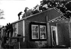 """BOYKIN - Women hammered out three homes last week.boykin -  - Habitat and the X Chromosone -  - There'll be lots of hungry women and you. That's the - basic pitch CL columnist Shannon Reichley - used to entice me to be a """"celebrity server"""" at last - week's Charlotte's Women Build project. By the time I - showed up at the work site around lunchtime on a - brisk Thursday afternoon, there wasn't much for me to - do but hand out sandwiches, stay out of the way and - look pretty. -  - Most of the women -- including Creative - Loafing's own bevy of intrepid female volunteers -- - had been hard at work since 8am that morning. All last - week hundreds of volunteers had strapped on tool - belts and donned hard hats as they braved the cold, - rain and mud to build three homes in a little over a - week. Habitat for Humanity of Charlotte sponsored the - project as part of a nationwide effort that focuses on - women's ability to transform their and their children's - lives and address the fact that more than 12 million - children in the US are living in poverty. -  - Working alongside the volunteers were the three - homeowners: two single mothers with daughters, and - a single man whom workers dubbed the """"the luckiest - man in Charlotte."""" All have completed 75 hours of - sweat equity as per Habitat guidelines. Plans are for - the families to move into their new homes by the first - of the year. -  - """"I've worked with different volunteer organizations for - over 10 years, and I've never been around such a - positive group,"""" said Lisa Quisenberry, Habitat for - Humanity of Charlotte's Project Chair. """"Even when it's - cold and raining and people are covered in mud or - smash their finger with a hammer, there have been no - complaints. I think this project has provided women - with a great experience and a real sense of - accomplishment."""" -  - In 1991, Habitat for Humanity of Charlotte was the first - affiliate in the nation to have a home constructed - completely by women. Since th"""