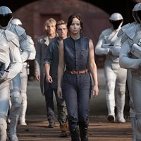 Woody Harrelson (back), Josh Hutcherson and Jennifer Lawrence in The Hunger Games: Catching Fire. (Photo: Lionsgate)