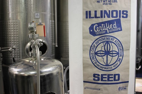 A bag of Illinois grain tacked on a column.