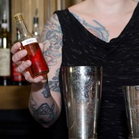 Step-by-step instructions for making a Barrelhouse Flat bartender's Takis cocktail A dash of chile arbol syrup Eileen Meslar