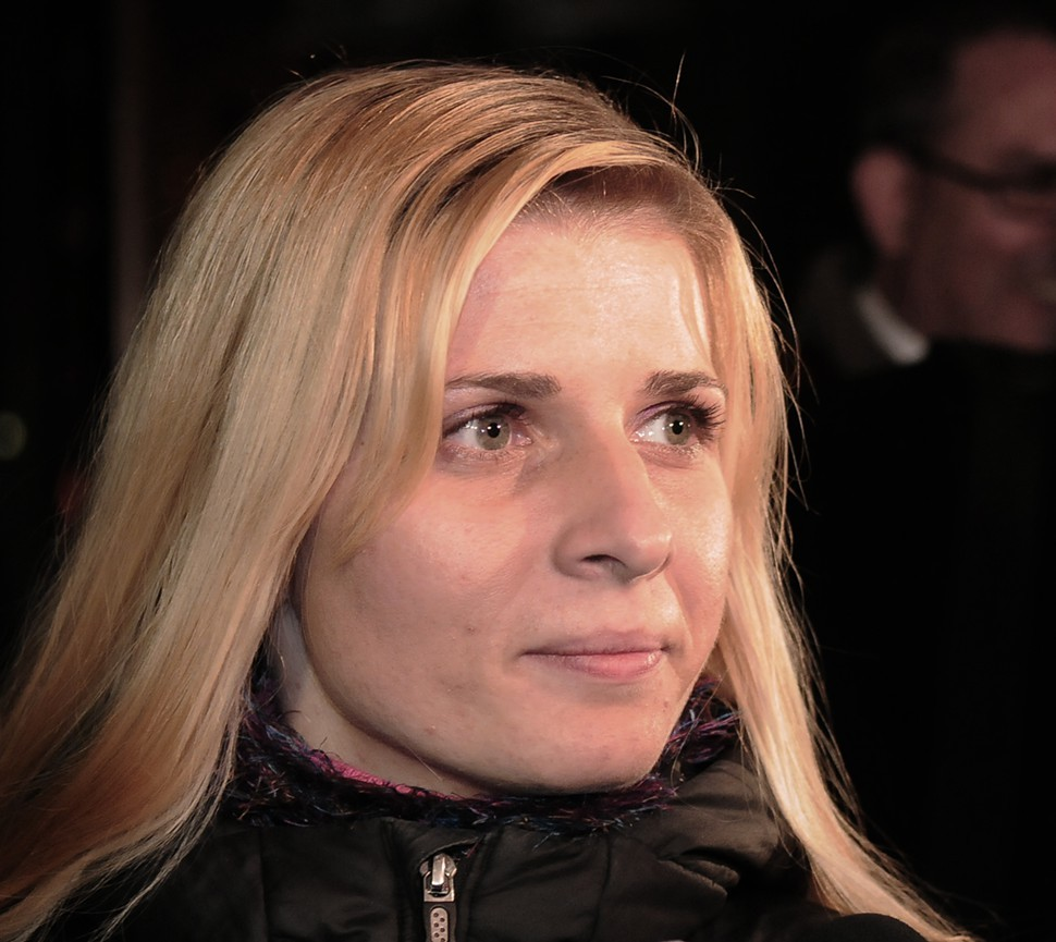 A federal jury awarded Karolina Obrycka $850,000 after she was beaten by an off-duty Chicago police officer.