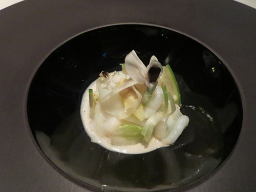 A full moon of escolar, sepia, white asparagus and a sake cream.