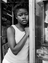 A Girl in a Deli Doorway (1988), by Dawoud Bey