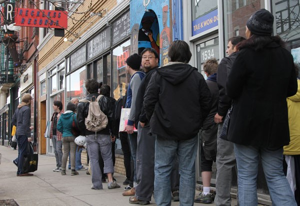 A line forms at Reckless Records in Wicker Park - ROBERT LOERZEL