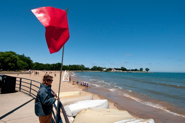 A red flag at 95th Street Beach signals the beach is closed for swimming - LLOYD DEGRANE