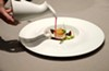 A seared-then-chilled scallop doused in a bloodred hibiscus tea