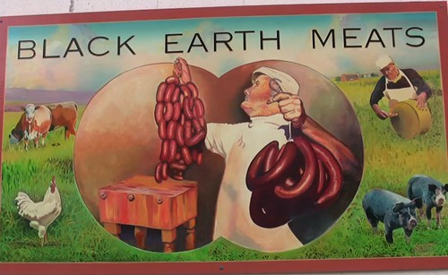A sign on the exterior of Black Earth Meats