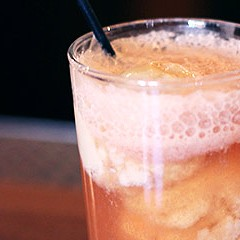 A Trenchermen bartender makes a porky peach-soda float