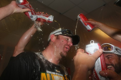 Adam Dunn celebrating Sunday after the As made the playoffs. His postseason career was shortlived.