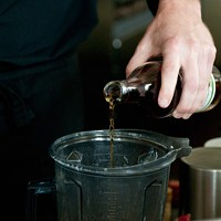 """Spiaggia's Brendan Smith whips up some """"dessert mustard"""" Add an ounce of the cognac. Andrea Bauer"""