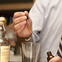 Patrick Henagahn makes the I Must Have Flown the Coop Add eight drops of the tincture to the drink. Andrea Bauer