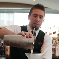 Mike Freeman makes his P'nut-Bourbon Julep Add ice and shake some more to finish the froth, then strain into a chilled martini glass. Andrea Bauer
