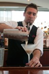 Add ice and shake some more to finish the froth, then strain into a chilled martini glass.