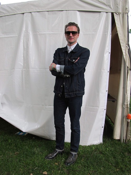 Aidan of Wild Beasts. Wants to see: St. Vincent. Why this outfit? Mostly ptacticality. Ive been traveling for one month on only one hand luggage, and double denim is very forgiving of everything you kinda have to brave through when youre touring.