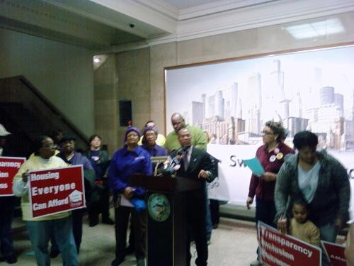 Alderman Walter Burnett speaks to an enthusiastic crowd at City Hall