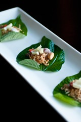 An amuse-bouche served on betel leaves - ANDREA BAUER