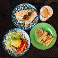 """Five favorite vegetarian meals at nonvegetarian restaurants """"The veggie tacos from Irazu: corn tortillas, black beans, vegetable rice, lettuce, tomato, and avocado. A basket or two of chips and salsa, mandatory side of yuca fries, and an oatmeal shake.""""—Dan Staackmann, founder of Upton's Naturals Andrea Bauer"""