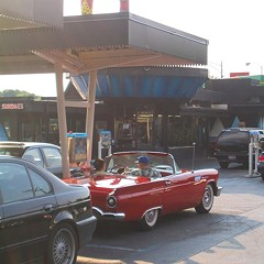 Antique cars have only one place to go for a dog, Superdawg.