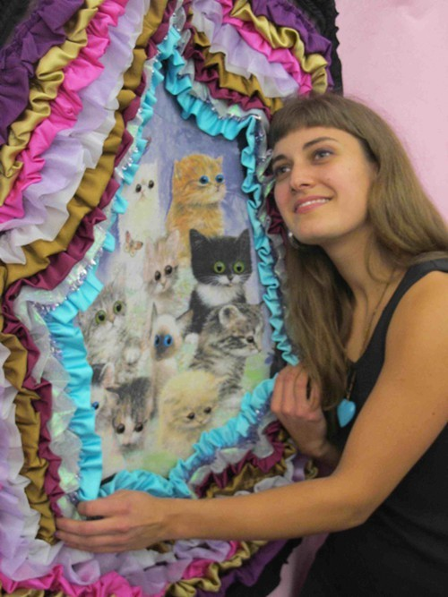 Artist Ellen Nielsen and her kitty backdrop