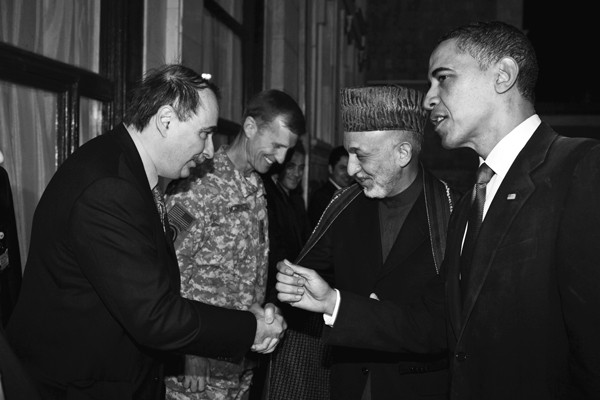 Axelrod greets Afghanistan president Hamid Karzai at the presidential palace in Kabul in 2010.
