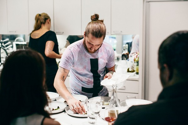 Baltzley's May pop-up dinner at the home of the parents of his wife, Leigh Hansen (standing behind him), was a tribute to the menu he conceived—but never got to execute—at Tribute. - JEFFREY MARINI