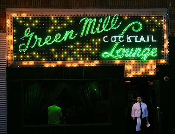 Bartender Jason Cole and the Green Mill's iconic sign - RICHARD A. CHAPMAN/SUN-TIMES MEDIA