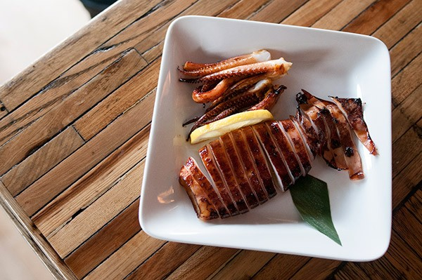 Bigger appetites can be satisfied with Izakaya Mita's larger plates, like the whole grilled squid.