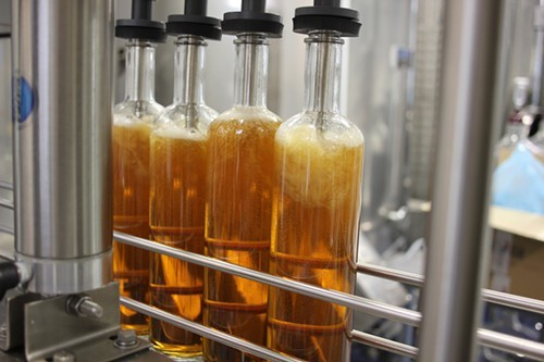 Bourbon being bottled.