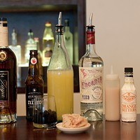 Step-by-step instructions for making a Blackbird bartender's cod milt cocktail Braun's components: aged rum, stout, fresh lemon juice, pisco, cod milt puree, orange bitters; (front) rum-soaked boba pearls, thawed cod milt
