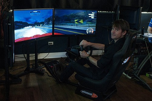 Brian Dressler plays a simulated racing game at M1 Interactive