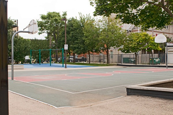 Broncho Billy playlot, Uptown: The basketball rims were removed to stem gang activity, but some residents say it's an attack on black kids who played ball there. - ANDREA BAUER
