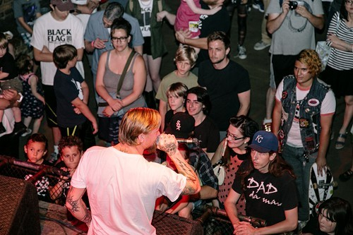 Can you spot the person wearing a Black Flag T-Shirt?