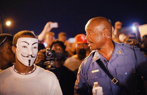 Captain Ronald Johnson of the Missouri State Highway Patrol talks with protesters in Ferguson, Missouri, after being put in charge of security there.
