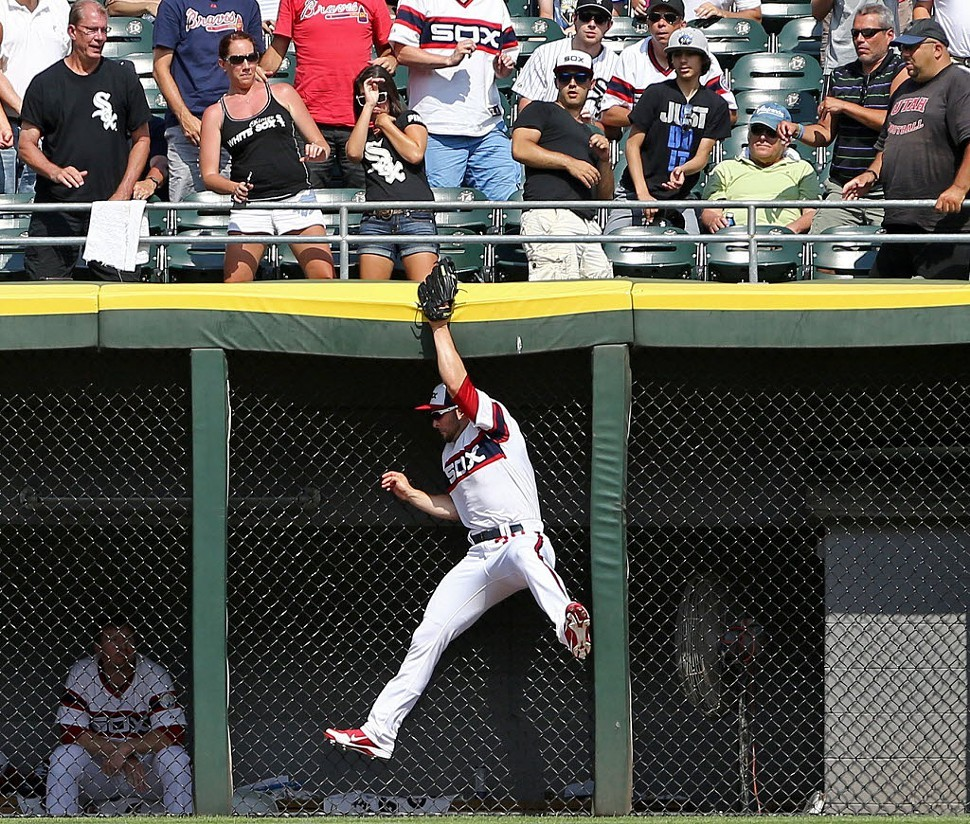 Casper Wellss leaping catch deprives Atlanta of a game-tying homer yesterday.