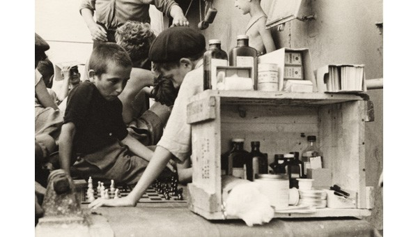 Children playing chess on the deck of the Henry Gibbins (1944)
