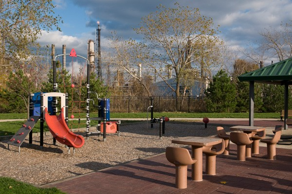 Children's playground in Whiting, with the refinery in the background - LLOYD DEGRANE
