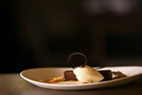 """""""Chocolate pretzel bar,"""" rich and minimally accented with smears of caramel and a scoop of pretzel-flavored ice cream - COURTESY THE REFINERY"""