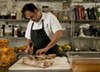 Chris Pandel, chef at the Bristol, cleaning pig trotters