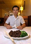 "Chungjun ""Ben"" Li with black pepper-garlic steak at Double Li"