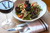 Clams and mussels on a bed of casarecci and stewed red peppers are reminiscent of Christmas on a plate. - MICHELLE SANGSTER