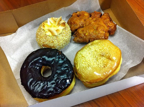 Clockwise from bottom left: Valrhona chocolate glazed, lemon-verbena meringue, unassuming apple fritter, butterscotch praline