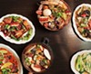 Clockwise from top middle: <em>arroz gordo</em> (fat rice), fat rice noodle, bok choy with pork stock, <em>balichang</em> catfish, African chicken, and shaking chile whitefish